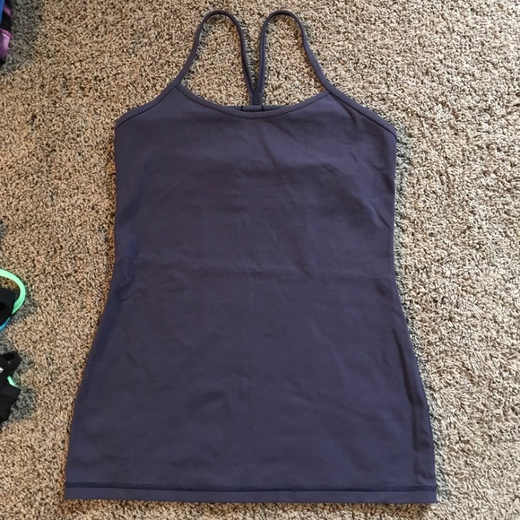 f1ea9d18e4d85 Previously loved lululemon black power y tank. lululemon athletica.  M 5caeaa9fffc2d4a6f4dd6d02. M 5caeaaa1b146cc49f75fd972